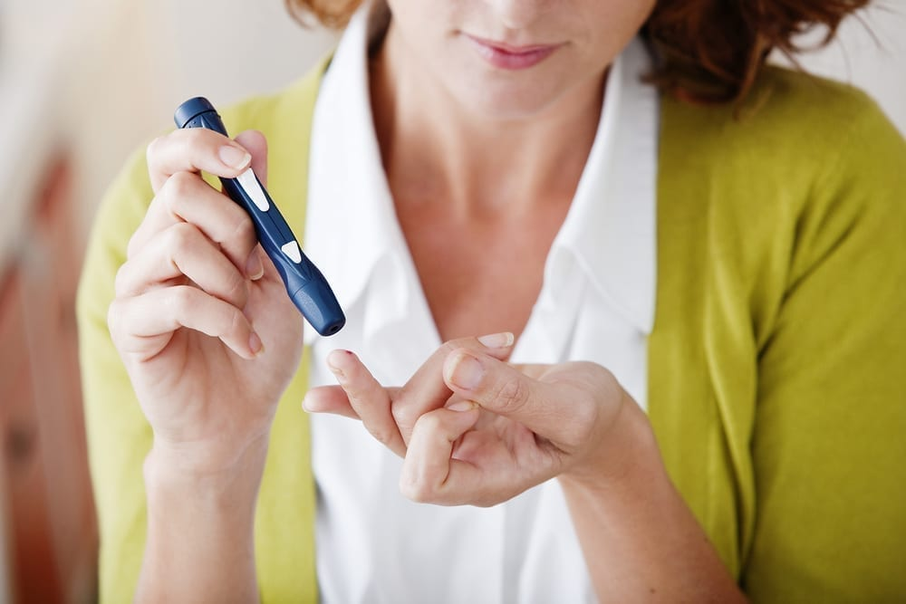 women testing insulin levels for diabetes